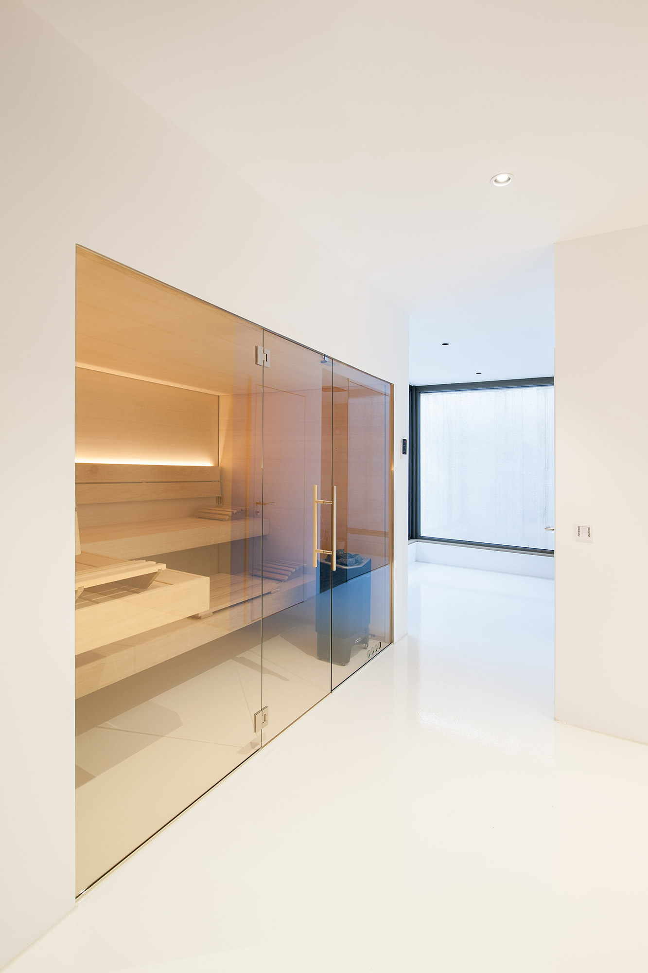 Villa Y Sauna im Untergeschoss FFM-ARCHITEKTEN.